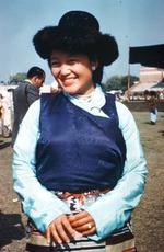 Female dancer wearing a black hat, possibly Tibetan