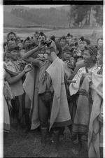 Apatani crowd and man with binoculars