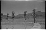 Apatani men carrying firewood