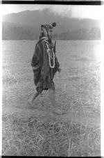 Apatani shaman during a ritual procession