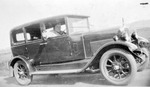 Photograph, R.F.C. Hedgeland in a car
